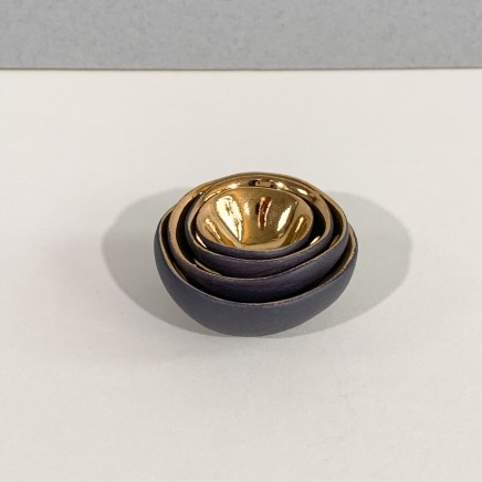 Penny Little Nest of 4 Minature Bowls Black Porcelain and Gold Lustre Smallest: 0.5 x 2 cm Largest: 2 x 5 cm