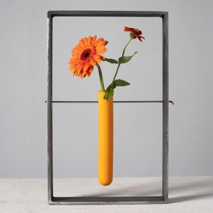 Lynne Rossington Orange Porcelain Test Tube Suspended within a Steel Frame. Slip cast, double fired matt glaze at 1240°c H: 33cm
