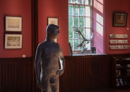 Pool of Narssisi, Robert Powell, with Christopher Marvell's standing man sculpture.