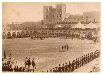 Antoin Sevruguin, Military ceremony in a meydan in Kermanshah, with Takieh Bozorg in the background, Late 19th Century