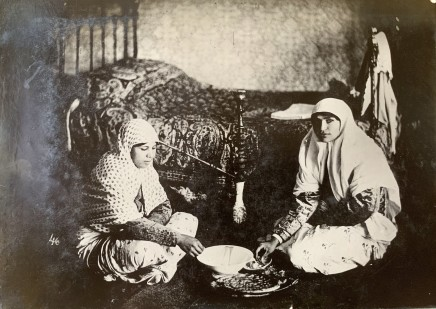 Antoin Sevruguin, Two women in a bedroom sharing food, Late 19th Century or early 20th Century