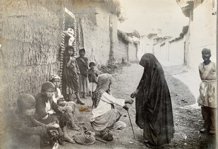 Antoin Sevruguin, A woman giving money to a poor man, Late 19th Century or early 20th Century