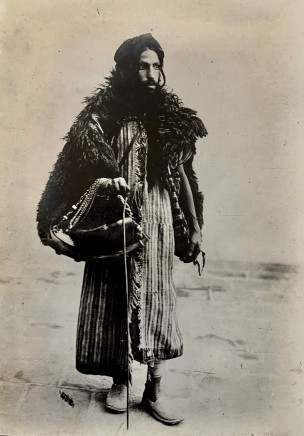 Antoin Sevruguin, A Dervish carrying a kashkul, or beggar's bowl, Late 19th Century or early 20th Century