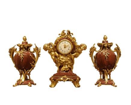 A three-piece clock garniture, Louis XV style, circa 1880