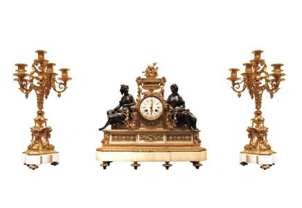 Gilt-bronze three-piece clock garniture