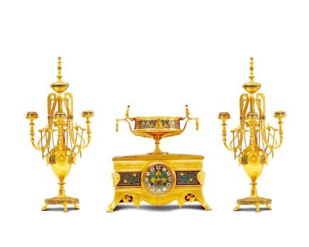 Ferdinand Barbedienne, A gilt-bronze three-piece clock garniture, circa 1885