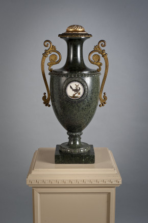 A green serpentine vase centred by a micromosaic round medallion depicting a bird and bronze handles