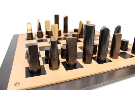 "<span class=""artist""><strong>Simon Hasan</strong></span>, <span class=""title""><em>Slice Chess Set</em>, 2012</span>"