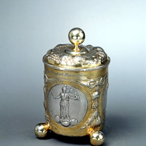 Pillip Jakob Drentwett II, A repoussé cup with a partially gilt silver cover, decorated with three medallions on the shaft, Augsburg, 1670 circa