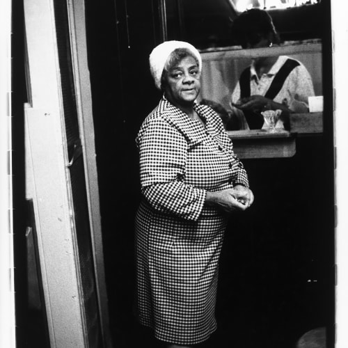 Ming Smith, Checkered Dress Lady Waiting for Order, Pittsburgh, PA, (August Moon Series), 1992