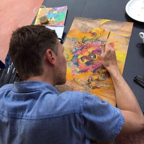 Baldridge in the process of creating one of his paintings