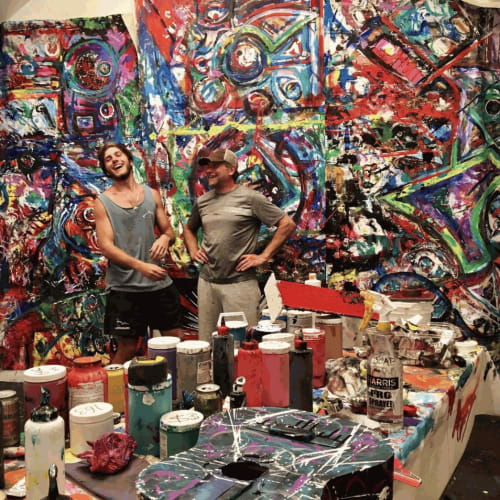 Brian in his studio with his son and fellow artist, Axel Anderson.