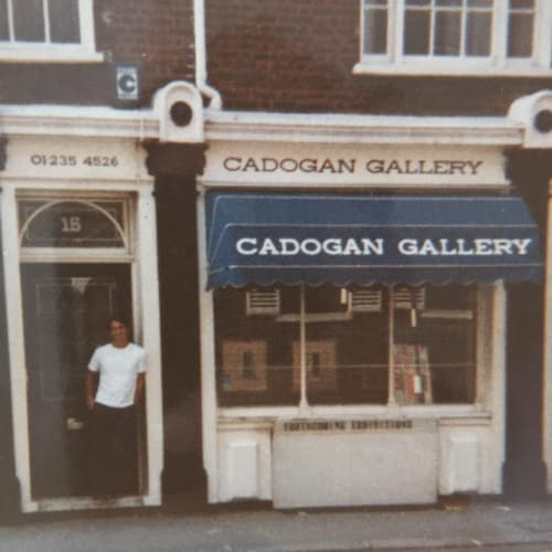 Christopher in front of the very first gallery on Pont Street, 1980s
