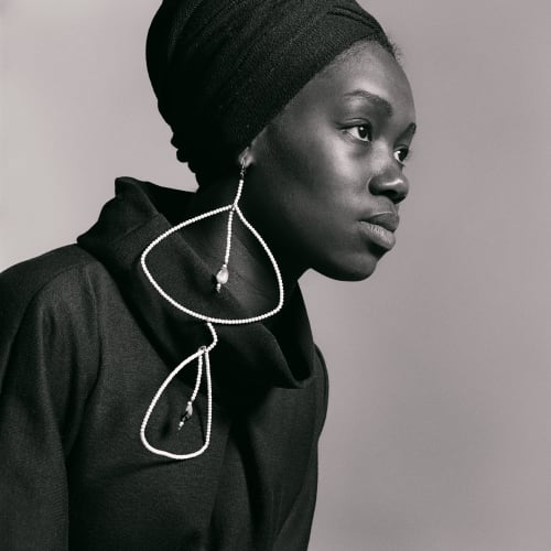 Kwame Brathwaite, Untitled (Nomsa Brath with earrings designed by Carolee Prince) (1964). Archival pigment print.
