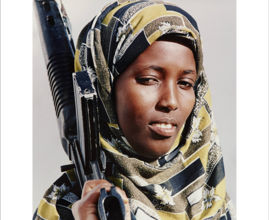 Dan Eldon, Somali Woman Holds A Rifle, 1993