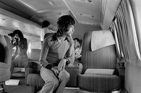 Jim Marshall, Mick Jagger on Airplane to San Diego, 1972