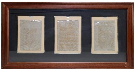Three magic slate boards mounted on grey card, 1974/75
