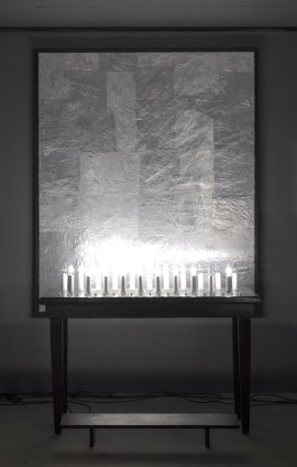 Thomas Zipp  SUBMISSION CHAPEL, 2012  Aluminium on silver painted canvas (whip), table and electrical candles  Painting: 180 x 150 cm, 70 7/8 x 59 1/8 ins Sculpture: 126 x 47 x 99 cm, 49 5/8 x 18 4/8 x 39 ins