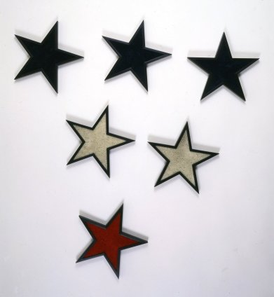 Robert Mapplethorpe  Stars, 1983  Stained wood and shag carpet  Each star 33 x 33 cms / 13 x 13 ins Installation dimensions variable stamped and signed by the Robert Mapplethorpe Estate