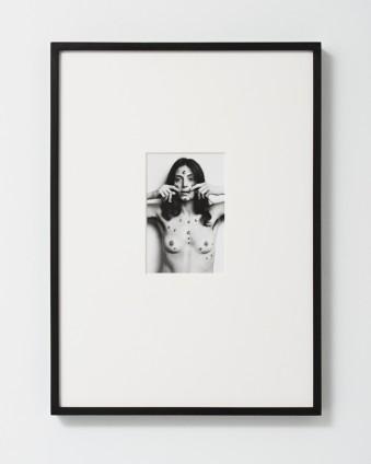 Hannah Wilke  S.O.S. Starification Object Series, 1974  Lifetime silver gelatin print  17.8 x 12.7 cm, 7 x 5 ins, paper size  54 x 39 cm, 21 1/4 x 15 3/8 ins, framed