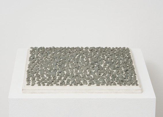 Hannah Wilke  Needed-Erase-Her #4, 1974  Kneaded erasers on painted board  2.5 x 33 x 33 cm, 1 x 13 x 13 ins  Signed 'Wilke 74' on front bottom right corner, signed 'Wilke' on verso