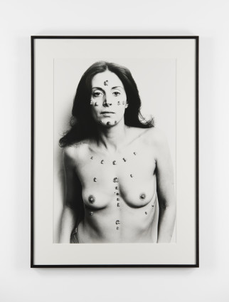 Hannah Wilke S.O.S Starification Object Series, 1974 Silver Gelatin Print 101.6 x 68.6 cm, 40 x 27 ins, paper size 125.8 x 91.5 cm, 49 1/2 x 36 1/8 ins, framed Signed, titled, dated and numbered 'AP1/2' in pencil on the reverse of the flush-mount.