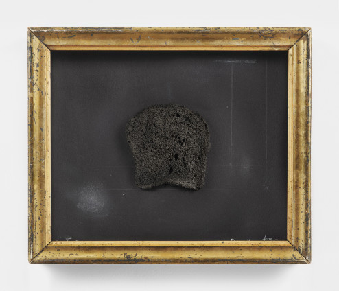 "Dorothea Tanning Victory, 2005 Burnt toast, graphite and crayon on black paper with antique frame 24.8 x 29.7 x 3.8 cm, 9 3/4 x 11 3/4 x 1 1/2 ins Signed and dated lower right, ""Dorothea Tanning 05"", inscribed lower left, ""Victory"""