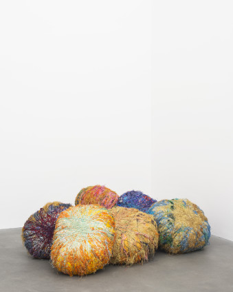 Sheila Hicks  Grand Boules, 2009  Linen, cotton, synthetic raffia, metallic fibre  8 elements:  Installation variable, diametre of individual elements range from 33.5 inches (85cm) to 45.3125 inches (105 cm)