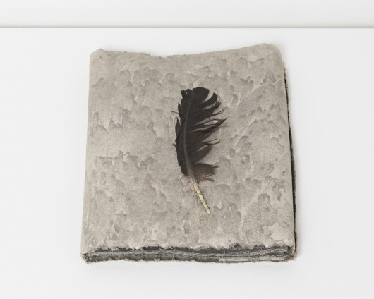 Wind Book, 1978 Earth and feather from site in Tikal Guatemala, muslin-mounted rag paper 33 x 25.4 x 3.8 cm, 13 x 10 x 1 1/2 ins © Michelle Stuart