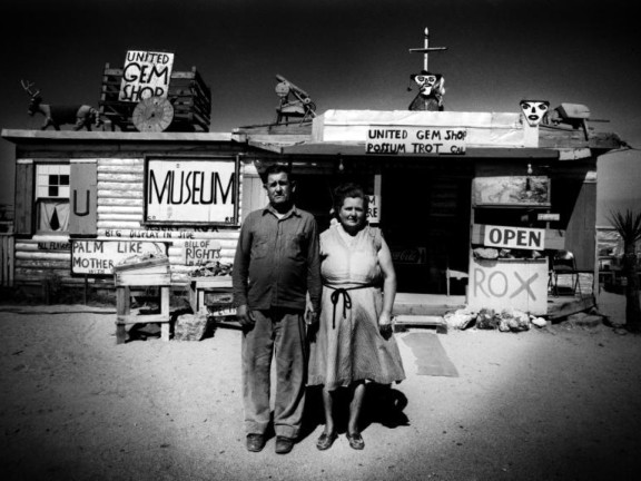 Call and Ruby Black in front of their museum, Mojave Desert, USA, 1960
