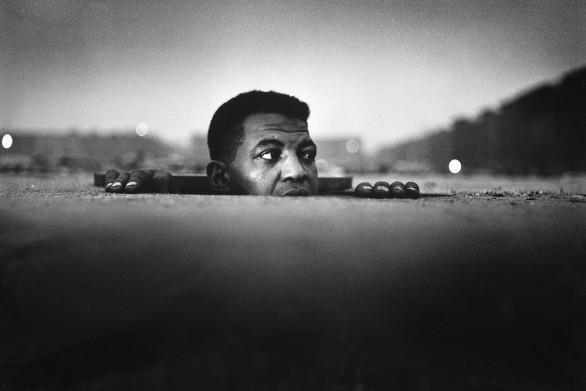 Gordon Parks, Man Emerging, Harlem, New York, 1952
