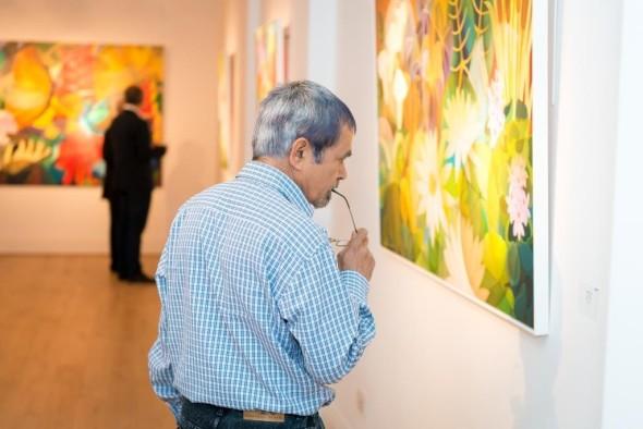 Shanti Panchal admiring a painting