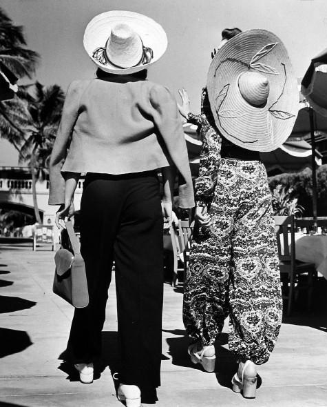 Model Stephanie Nikashian with friend in front of hotel. Miami Beach, FL, 1940
