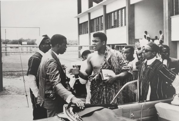 Muhammad Ali retraces his roots after winning his 1st Worlds heavyweight title. See talking to photographer Howard Bingham, Ghana, 1964