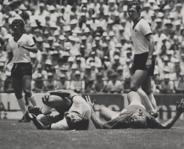 World Cup - Mexico Quarter Final, England v. West Germany, Bobby Charlton on ground (right)