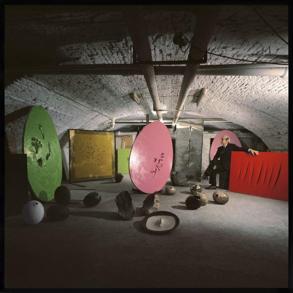 """<span class=""""artist""""><strong>Ugo Mulas</strong></span>, <span class=""""title""""><em>Lucio Fontana's Studio</em>, 1962</span>"""