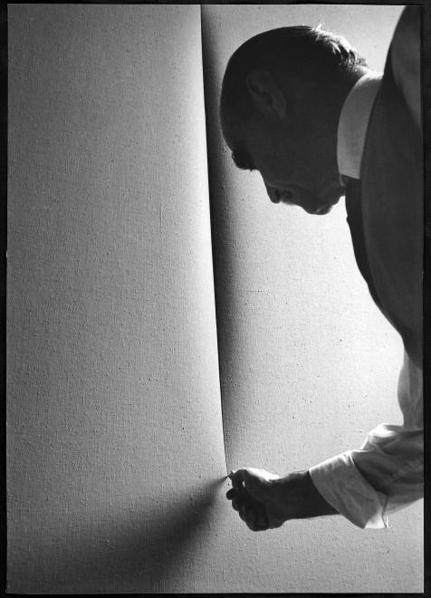 "<span class=""artist""><strong>Ugo Mulas</strong></span>, <span class=""title""><em>Lucio Fontana, L'Attesa, Milano (6)</em>, 1964-2019</span>"