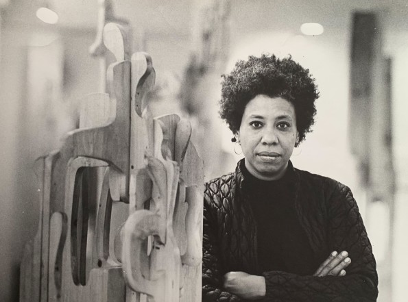 """<span class=""""artist""""><strong>Mildred Thompson</strong></span>, <span class=""""title""""><em>artist with a free-standing wood assemblage</em></span>"""