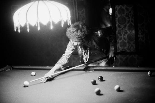 Ed Caraeff, Jimi Hendrix shoots pool at the Bel Air home of John and Michelle Phillips in Los Angeles, July...