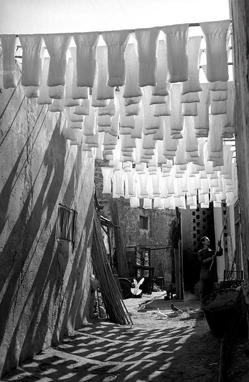George Rodger, Medina of Tunis. Skeins of cotton hanging to dry in dyers souk, Tunis, Tunisia, 1958.