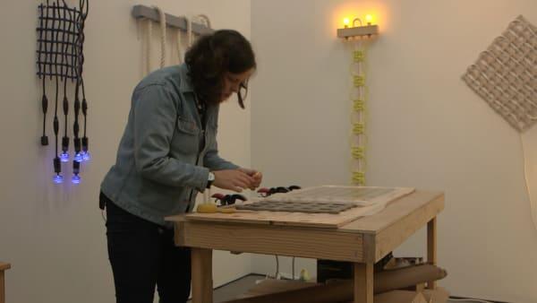Joe Rosato Jr. Artist Dana Hemenway works on an art piece inside her studio in the new 1240 Minnesota Street Studio space.