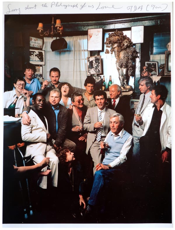 Members of the Colony Room Club photographed by Neal Slavin for his book Britons. Back row from the left: Michael Wojas, Tom Baker, Bruce Bernard, Liz McKenzie, Michael Clark, Allan Hall. Middle row: Mike McKenzie, Francis Bacon, Ian Board, John Edwards, John McEwan. Front row: Thea Porter (on the floor), Jeffrey Bernard, David Edwards (all images courtesy of Darren Coffield and Unbound).