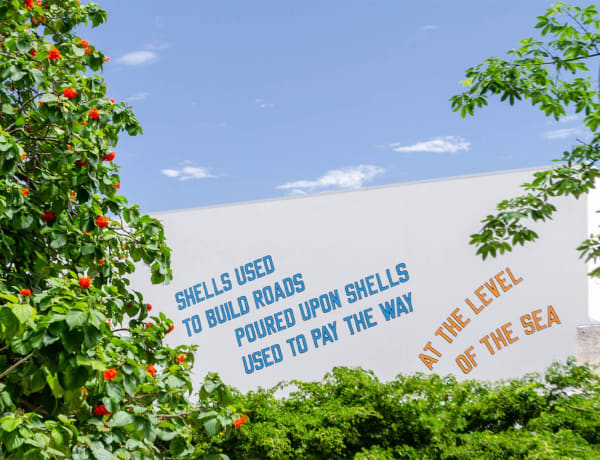 LAWRENCE WEINER: SHELLS USED TO BUILD ROADS POURED UPON SHELLS USED TO PAY THE WAY, AT THE LEVEL OF THE SEA (2008)