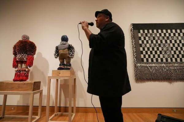 """Artist Jeffrey Gibson leads a tour through his exhibition, """"Like a Hammer,"""" currently on view at Seattle Art Museum. (Alan Berner / The Seattle Times)"""