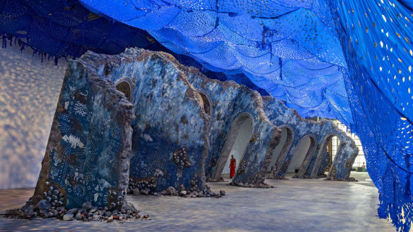 """In a monumental sculpture, the artist Firelei Báez reimagines the archaeological ruins of the Sans-Souci Palace in Haiti. The architecture of lurching walls and archways surges from the """"seafloor"""" of the ICA Watershed.Credit...Firelei Báez and James Cohan; Chuck Choi"""