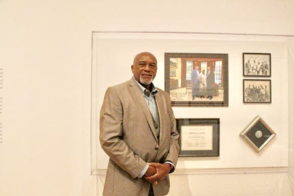 """Olympian Tommie Smith at the """"With Drawn Arms"""" exhibit at the High Museum of Art in Atlanta (Photo credit: Cassidy S)"""