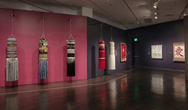Adorned punching bags by Jeffrey Gibson, found and ready-made materials.Courtesy of the Denver Art Museum