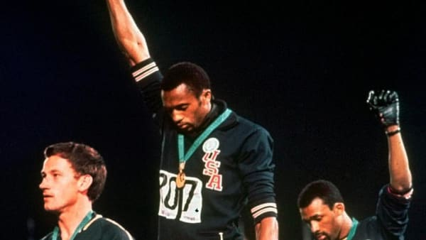 Tommie Smith, centre, and John Carlos, right, protest at the 1968 Olympics AP