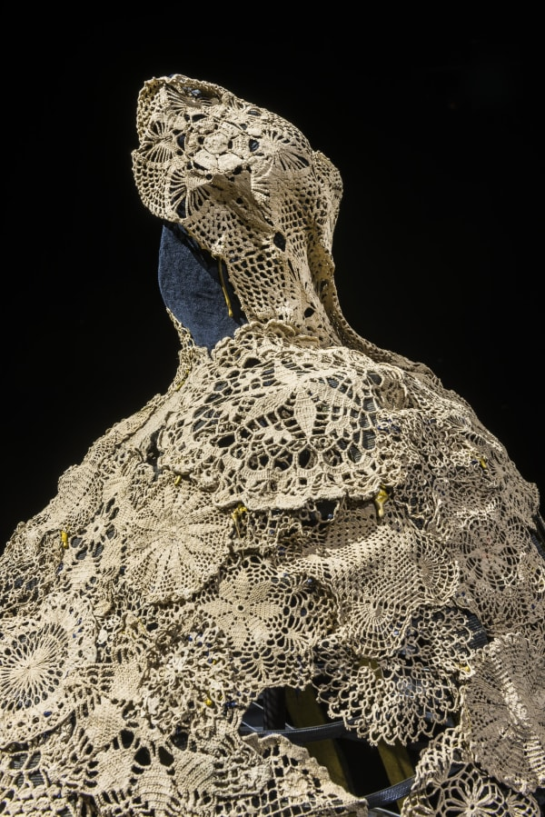 This 19th century crinoline made of steel and draped with lace that's been dipped in soil from Agnes Joaquim's garden was inspired by the woman herself, who created Singapore's national flower, Vanda Miss Joaquim.