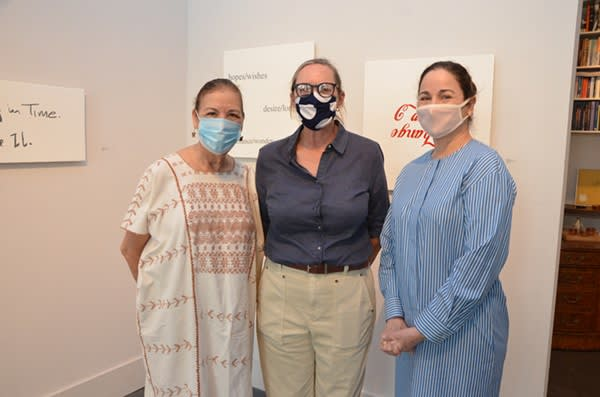 Trinity professor Norma Elia Cantú, artist Ethel Shipton and gallerist Patricia Ruiz-Healy pose in front of Shipton's work at Ruiz-Healy Art.